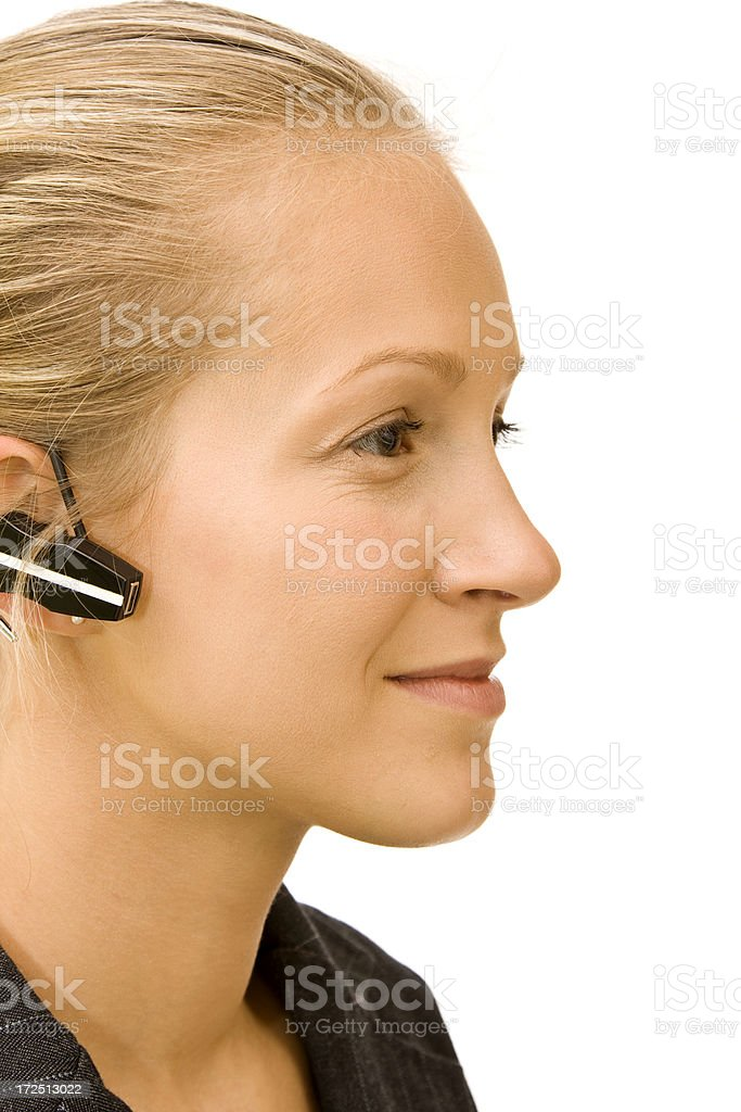Portrait of a woman with bluetooth headset royalty-free stock photo