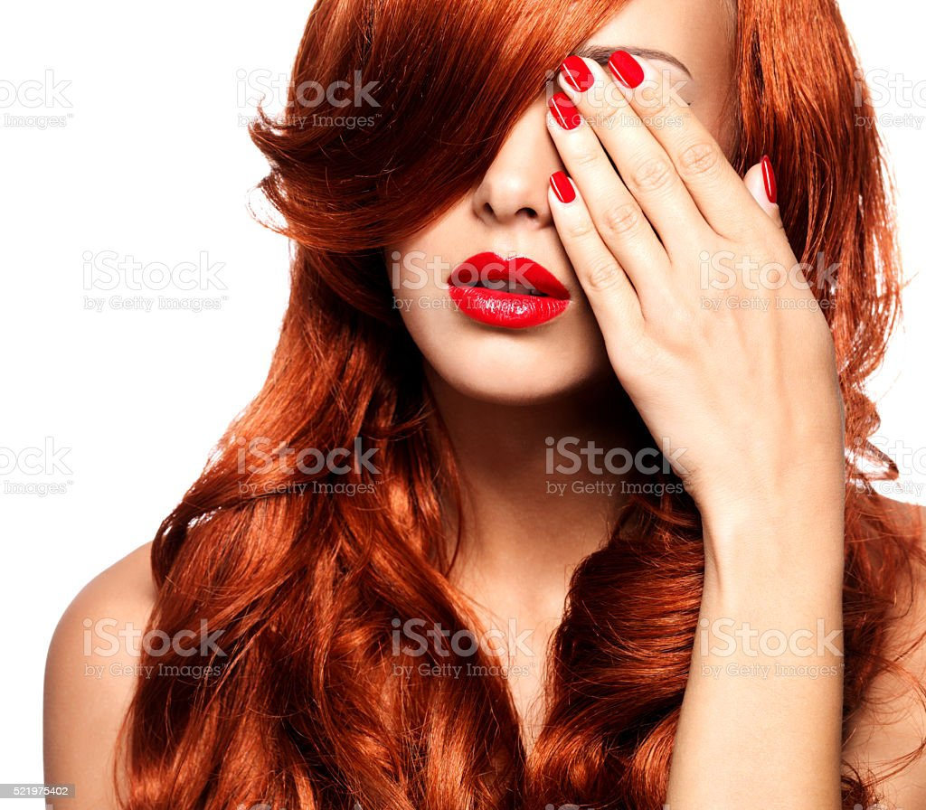 Portrait of a woman with bright red lips and nails stock photo