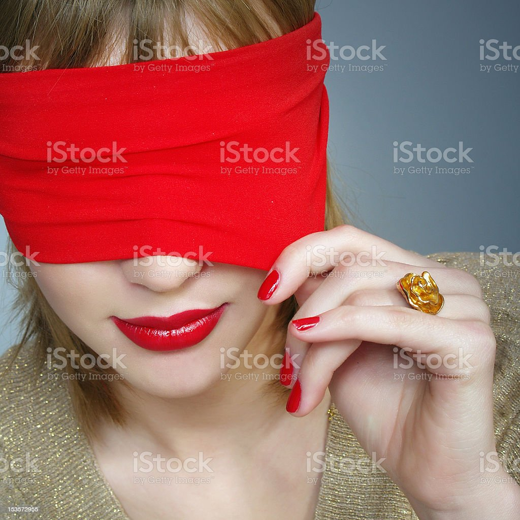 Portrait of a woman with covered eyes royalty-free stock photo