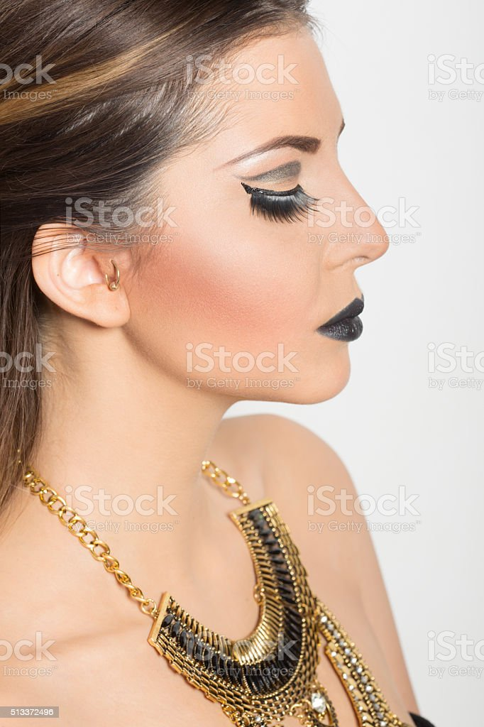 Portrait  of a woman with fashion make-up, and necklace stock photo
