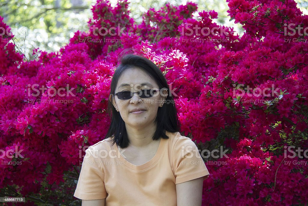 Portrait of a woman with flowered background stock photo