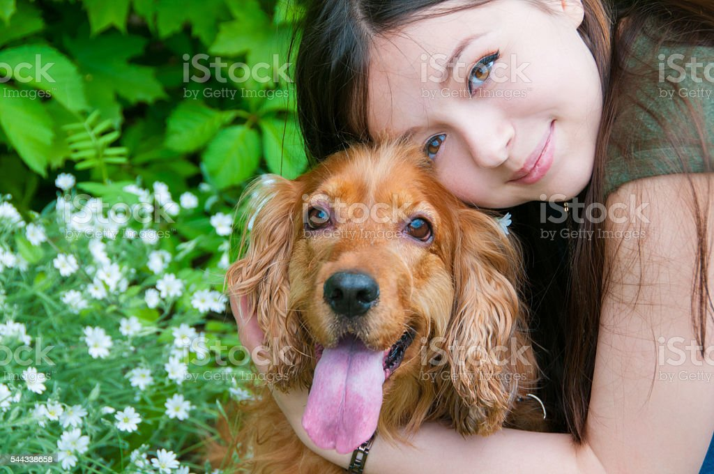 Portrait of a woman with her beautiful dog stock photo