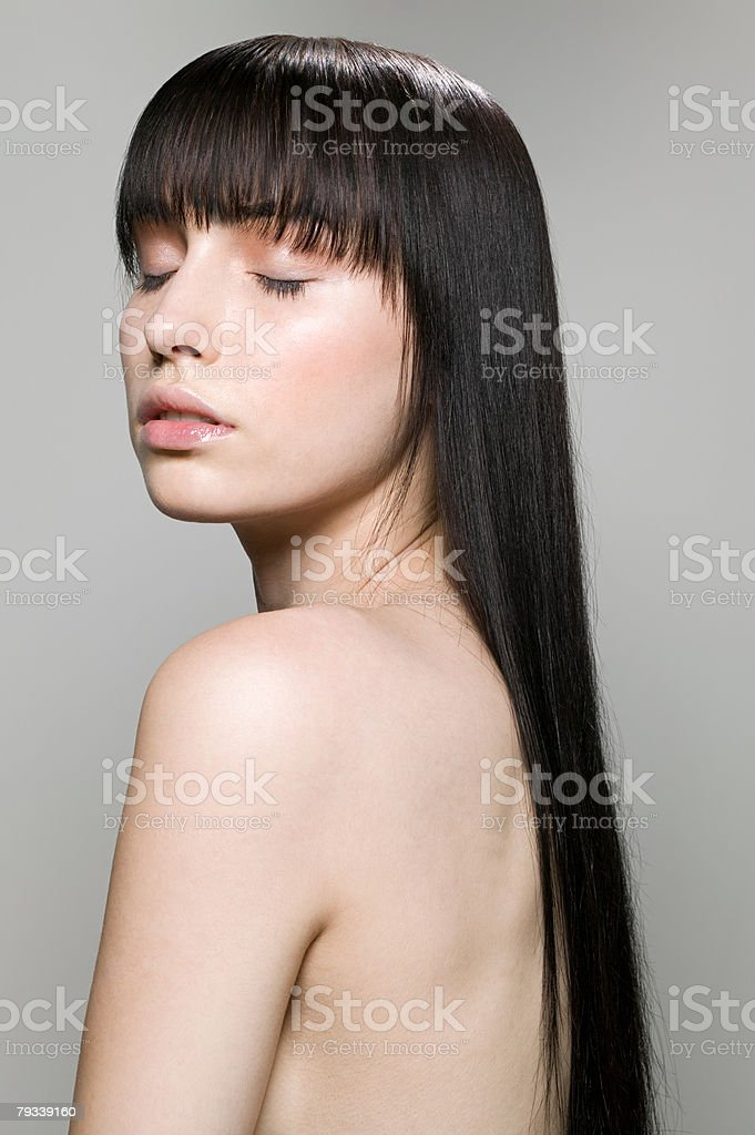 Portrait of a woman with her eyes closed royalty-free stock photo