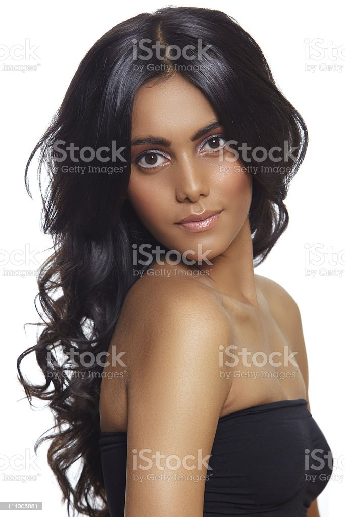 Portrait of a woman with long curly black hair stock photo