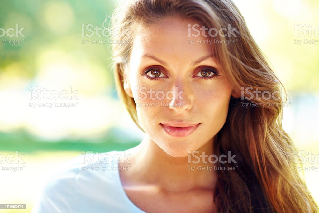 Portrait of a woman with long hair facing camera stock photo