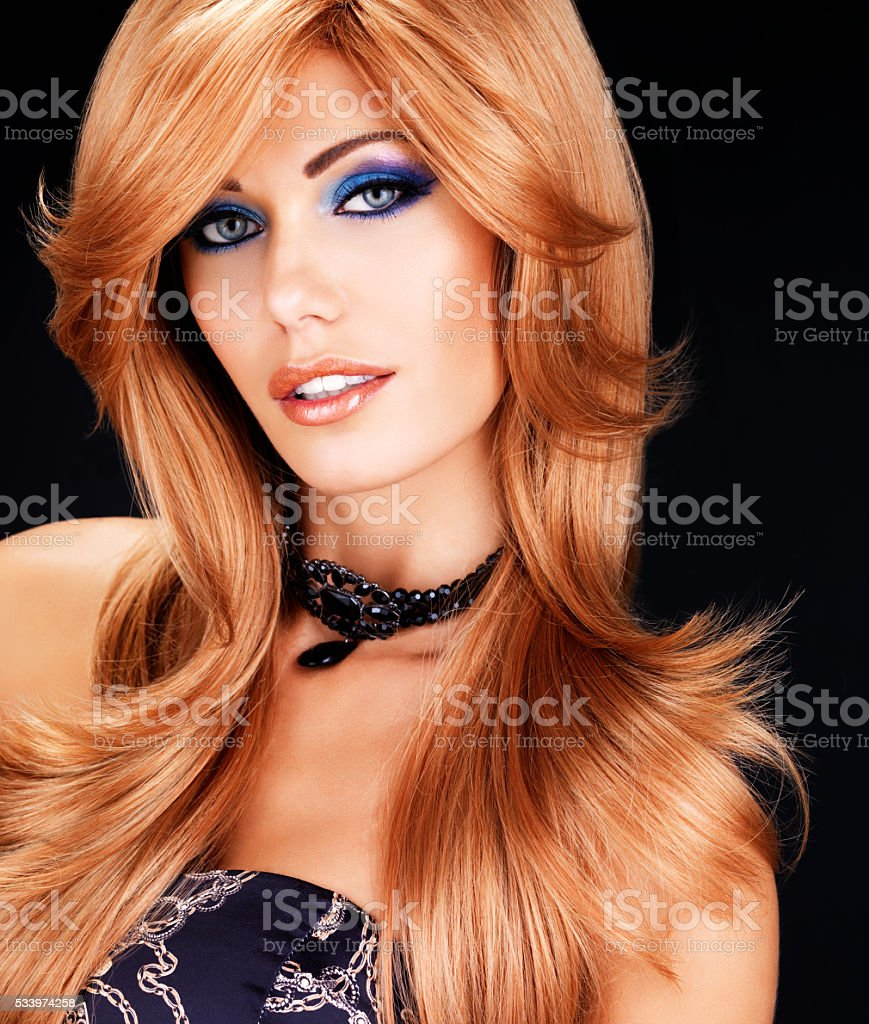 portrait of a  woman with long red hairs and  fashion stock photo
