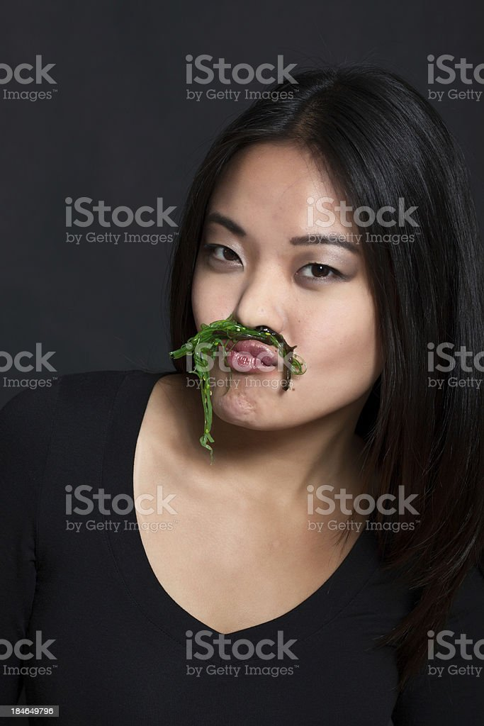 Portrait of a woman with seaweed moustache stock photo