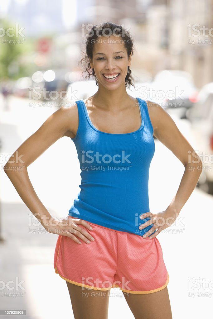 Portrait of a woman with workout clothes with hands on hips stock photo