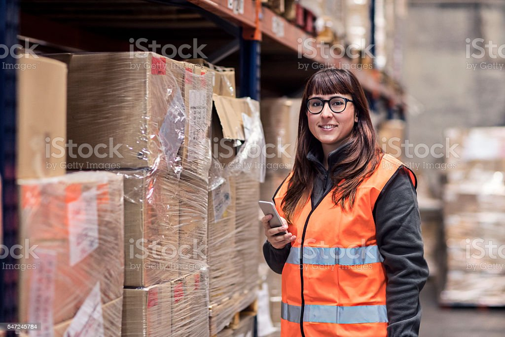 Portrait of a woman working in the warehouse stock photo