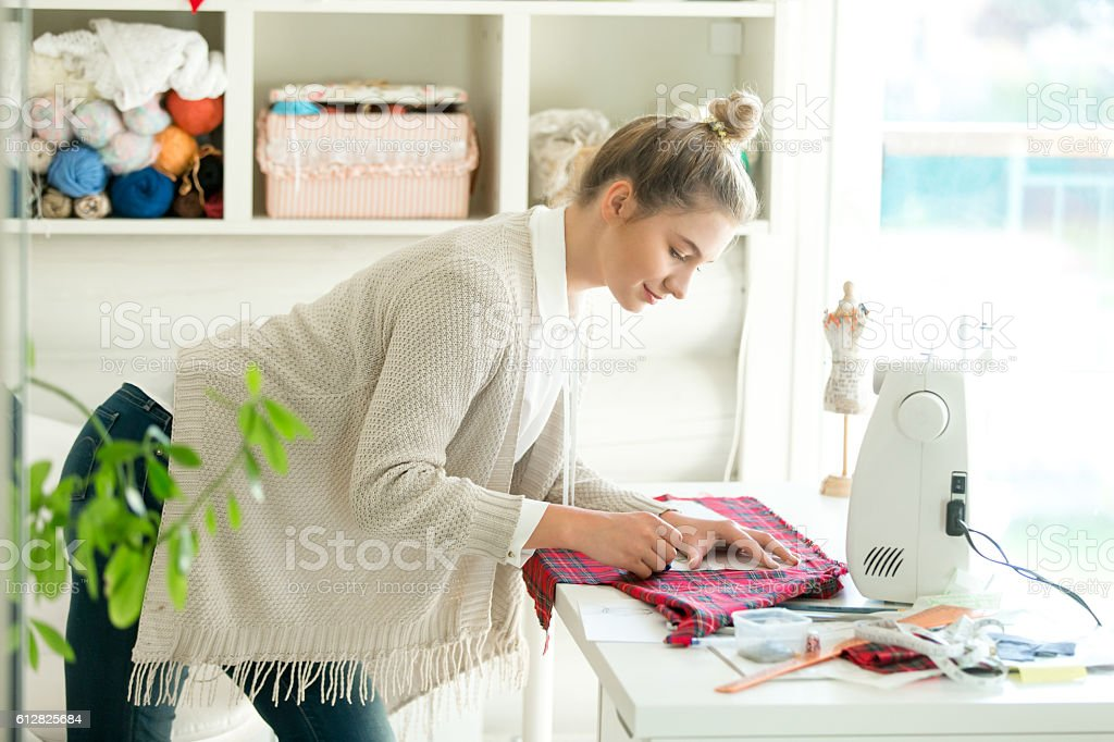 Portrait of a woman working with a sewing pattern stock photo
