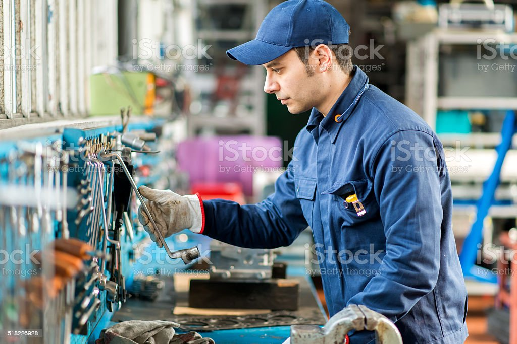 Portrait of a worker searching for the right tool stock photo