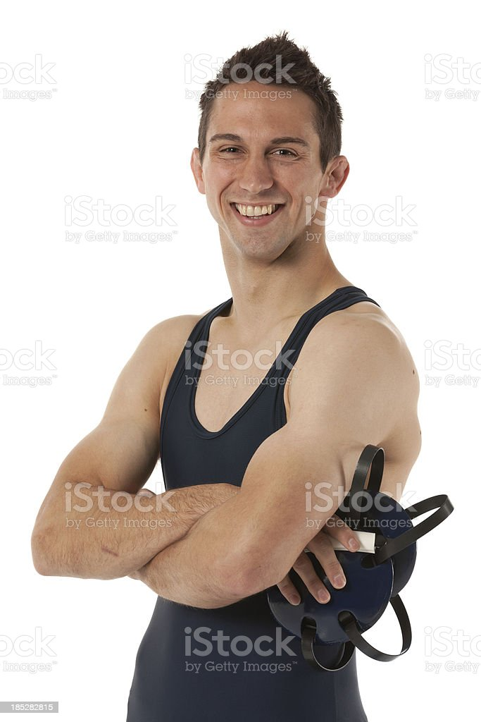 Portrait of a wrestler smiling with arms crossed stock photo