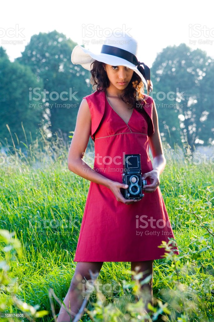 Portrait of a you woman with camera royalty-free stock photo