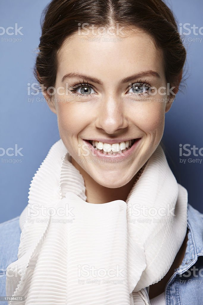portrait of a young adult on blue background royalty-free stock photo