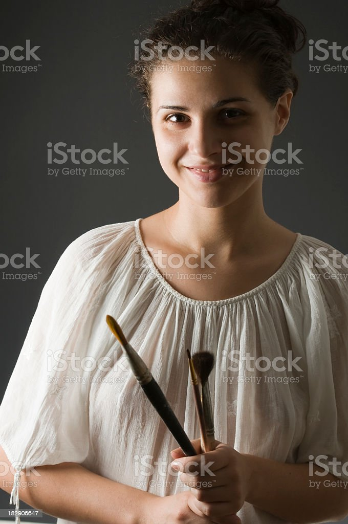Portrait of a young artist smiling stock photo