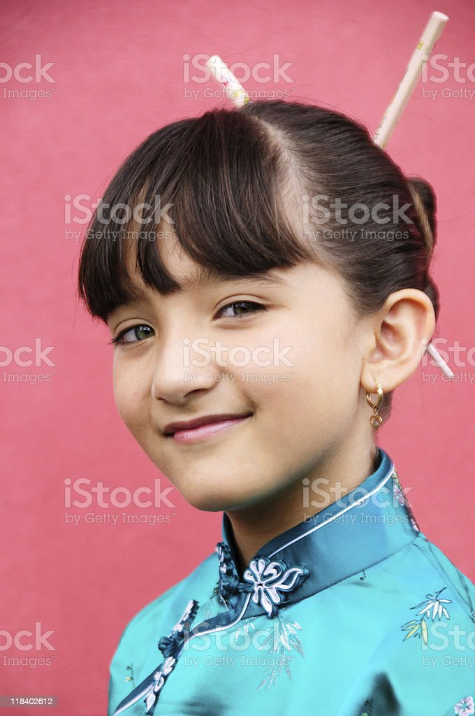 Portrait of a young Asian-Hispanic girl in oriental outfit stock photo