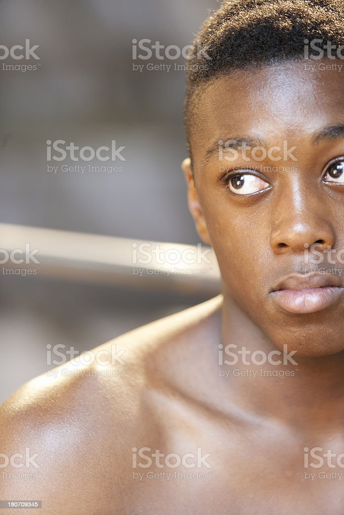 Portrait of a young athlete in fitness studio royalty-free stock photo