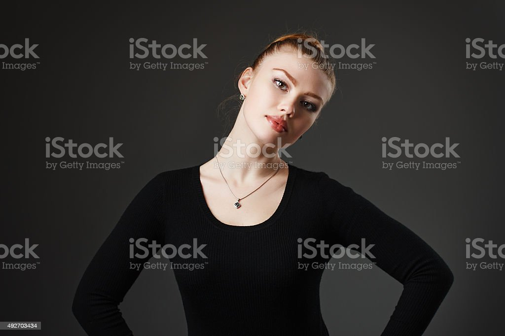 Portrait of a young beautiful girl in black stock photo