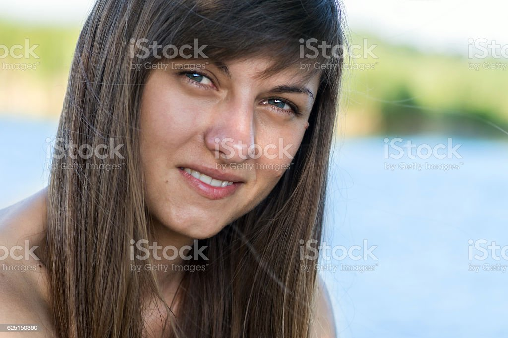 Portrait of a young beautiful girl with a smile stock photo