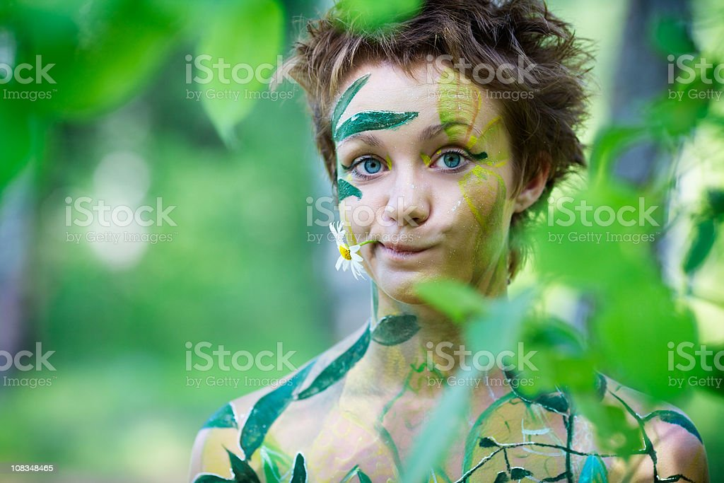 Portrait of a young beautiful playful nymphs with flower royalty-free stock photo
