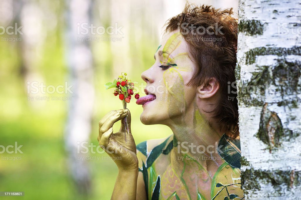 Portrait of a young beautiful playful nymphs with strawberries royalty-free stock photo