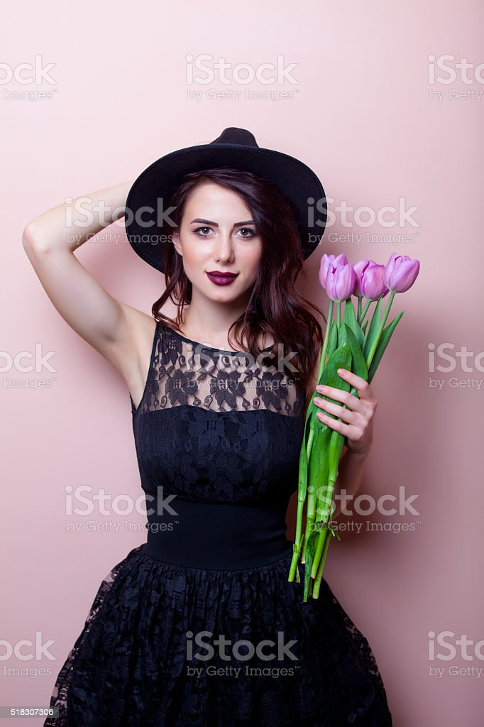 portrait of a young beautiful woman with flowers stock photo