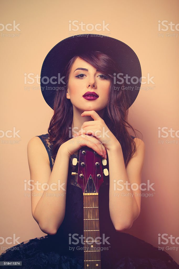 portrait of a young beautiful woman with guitar stock photo