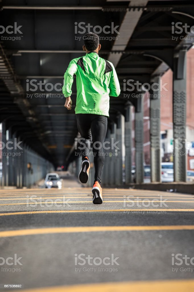 A portrait of a young, black man going for a run in Brooklyn, New York City stock photo