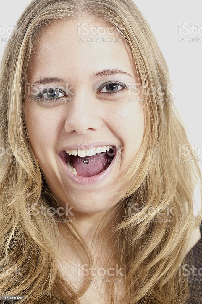 Portrait of a young blond woman with tongne piercing stock photo