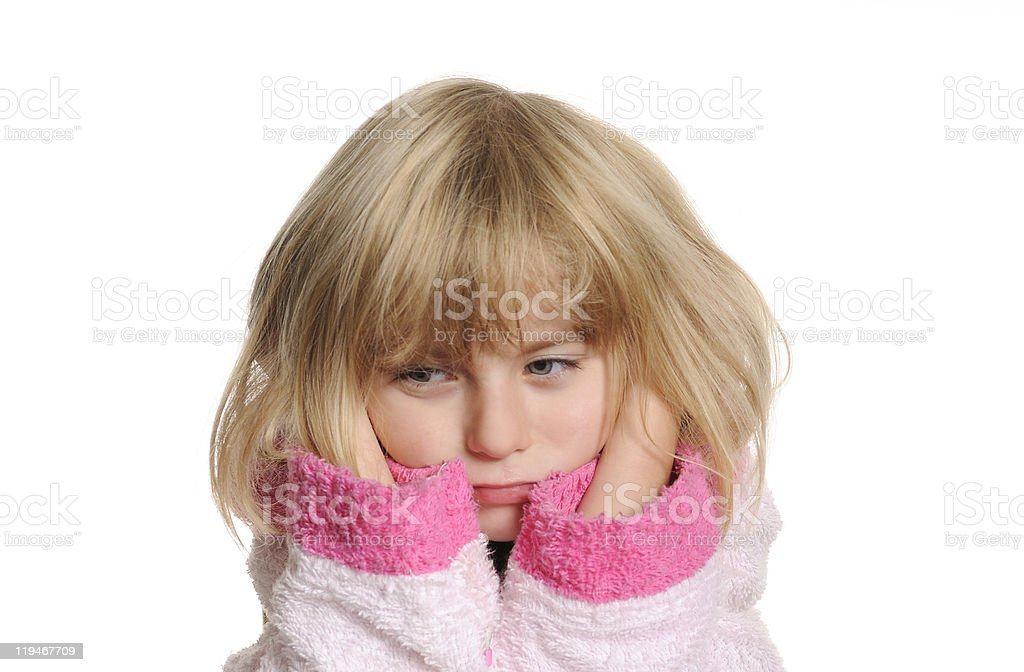 Portrait of a young blonde girl with an earache stock photo