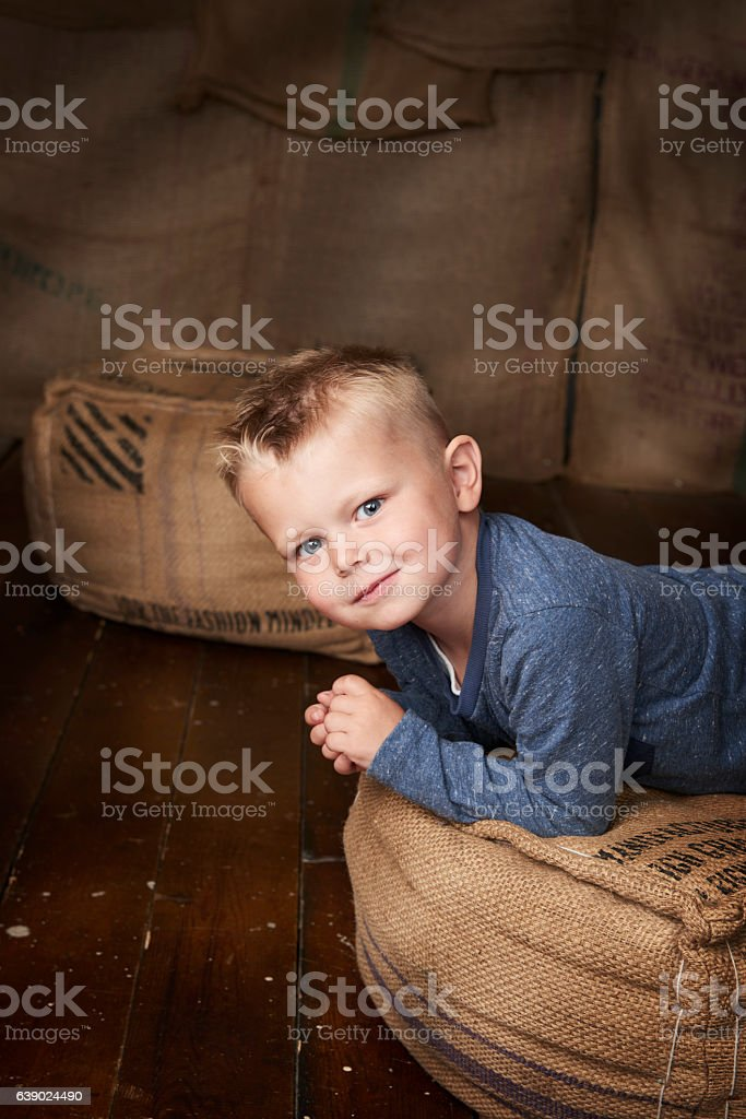 Portrait of a young boy on a beanbag stock photo