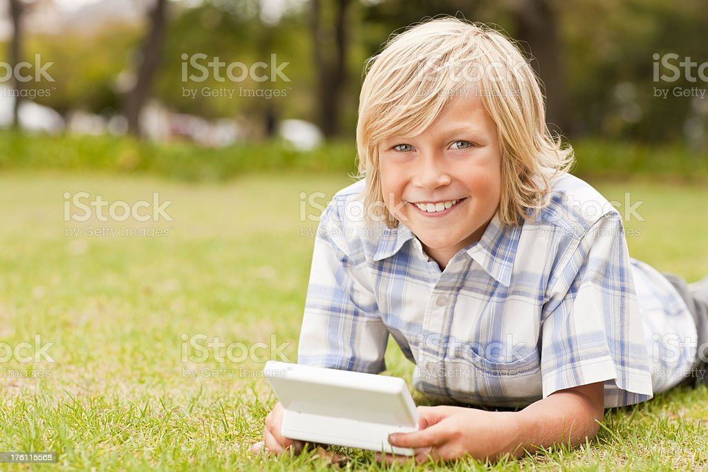 Portrait of a young boy playing video game royalty-free stock photo
