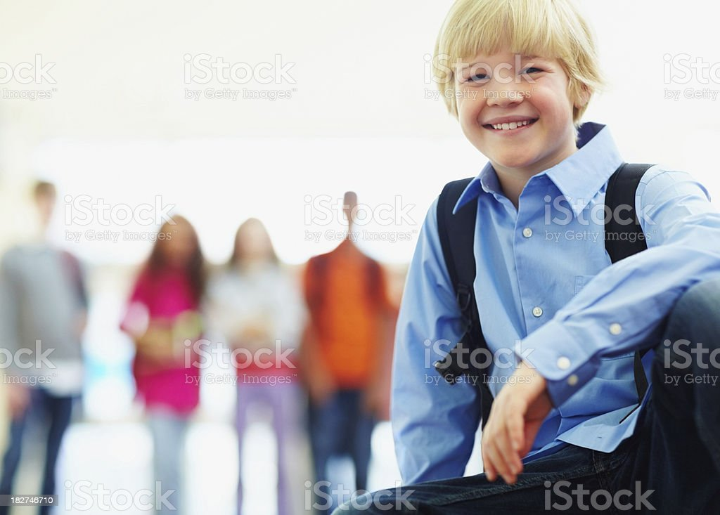 Portrait of a young boy with friends at background royalty-free stock photo
