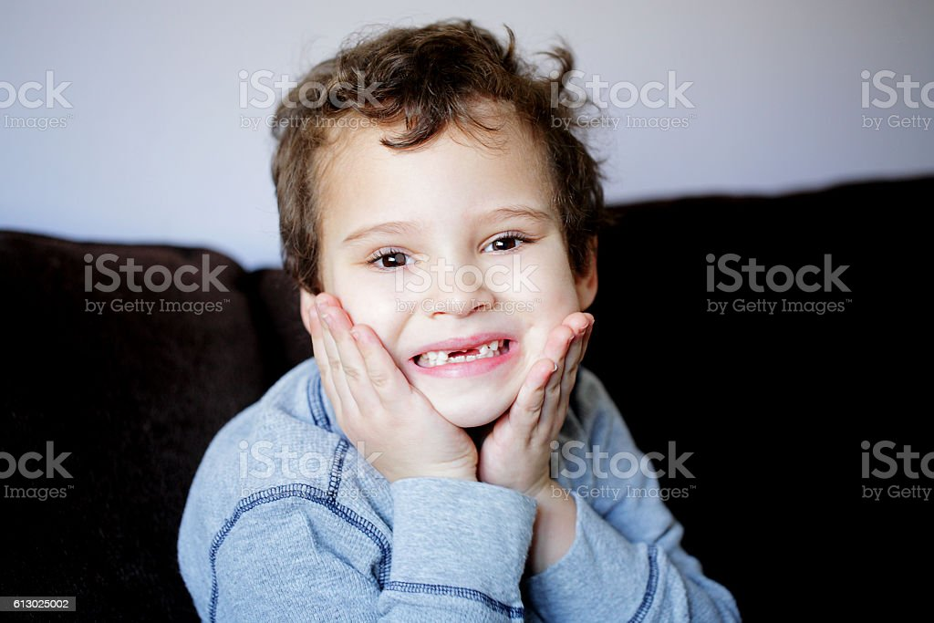 Portrait of a young boy with missing front teeth stock photo
