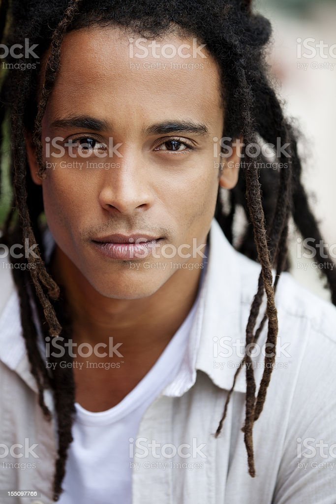Portrait of a young brazilian man outdoors stock photo