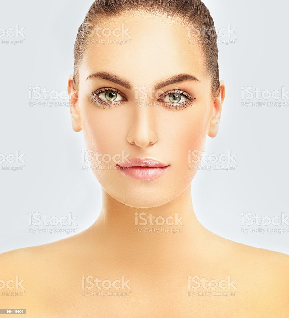 Portrait of a young brunette woman . stock photo