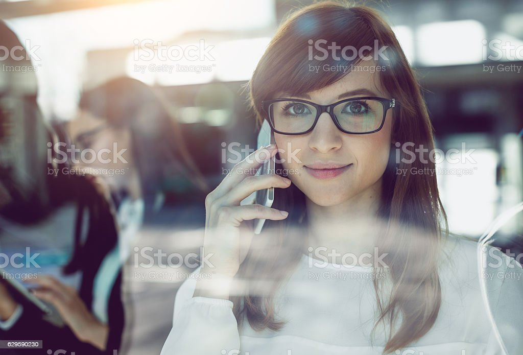 Portrait of a Young  Businesswoman Talking on Mobile Phone stock photo