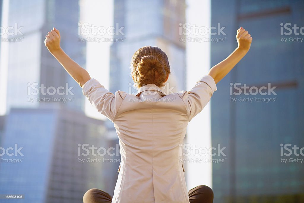 A portrait of a young businesswoman with arms outstretched stock photo