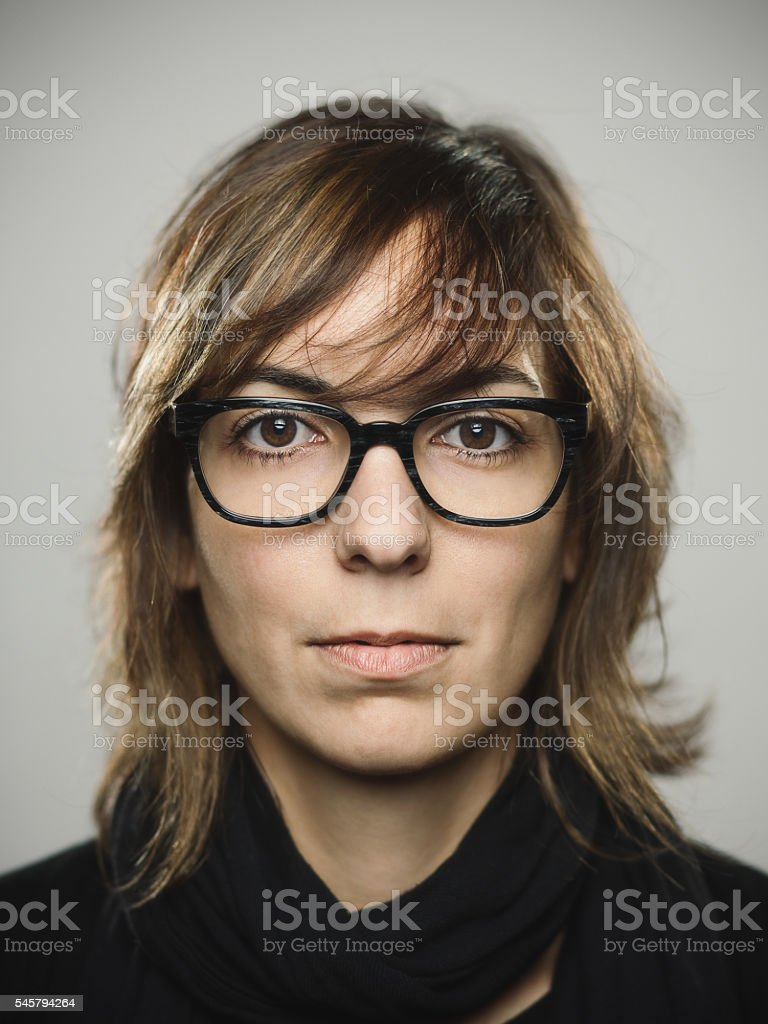 Portrait of a young caucasian woman looking at camera stock photo