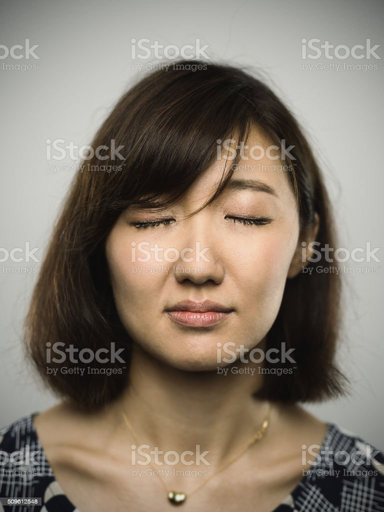 Portrait of a young chinese woman looking at camera stock photo