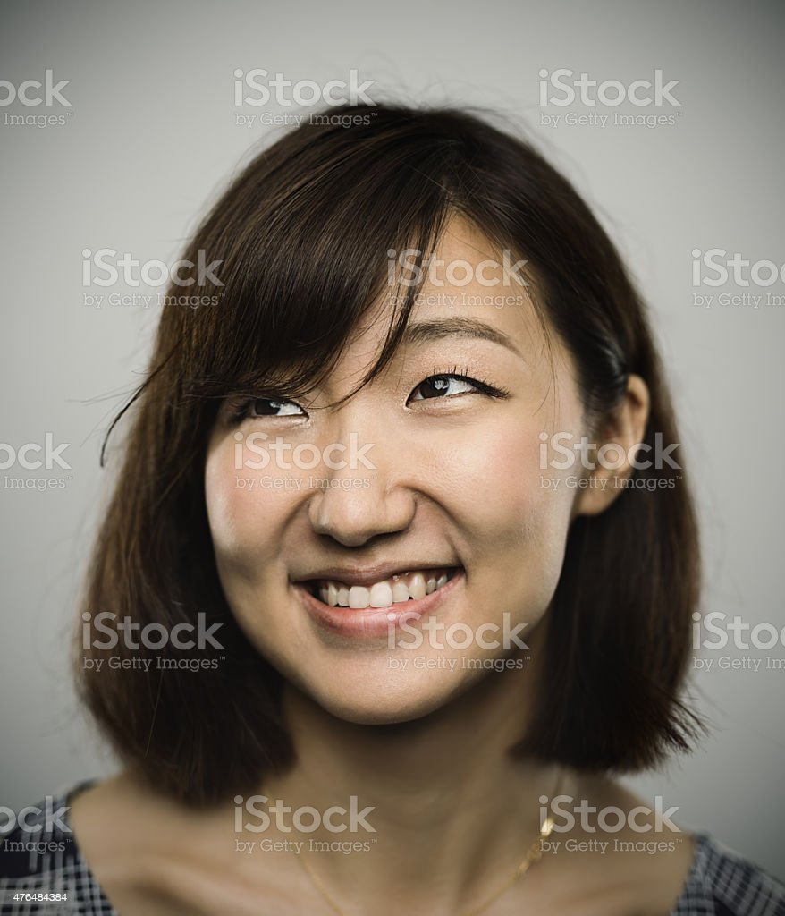 Portrait of a young chinese woman with happy smile stock photo