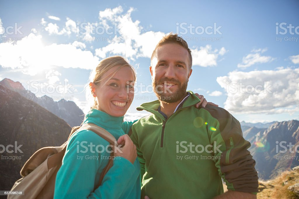 Portrait of a young couple hiking in Autumn stock photo