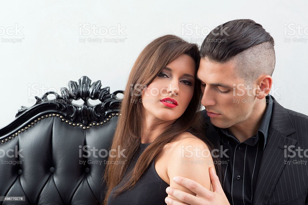 Portrait of a young couple in elegant black clothes stock photo