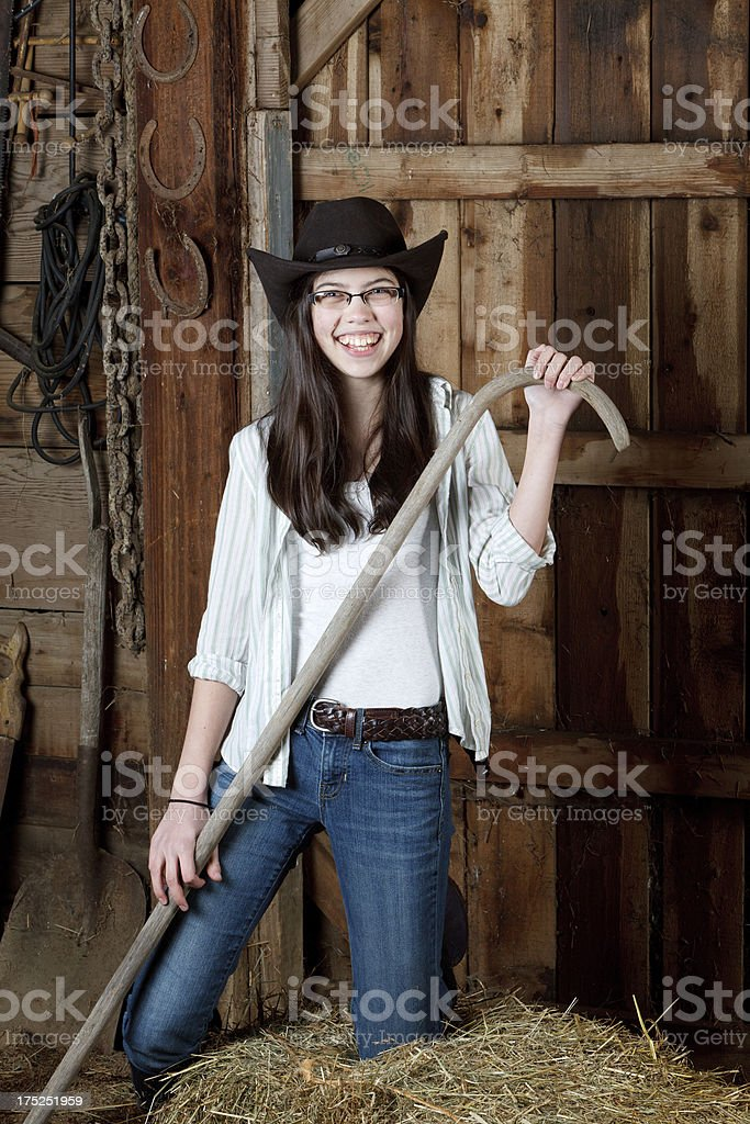 Portrait of a young cowgirl holding her sheep hook. royalty-free stock photo