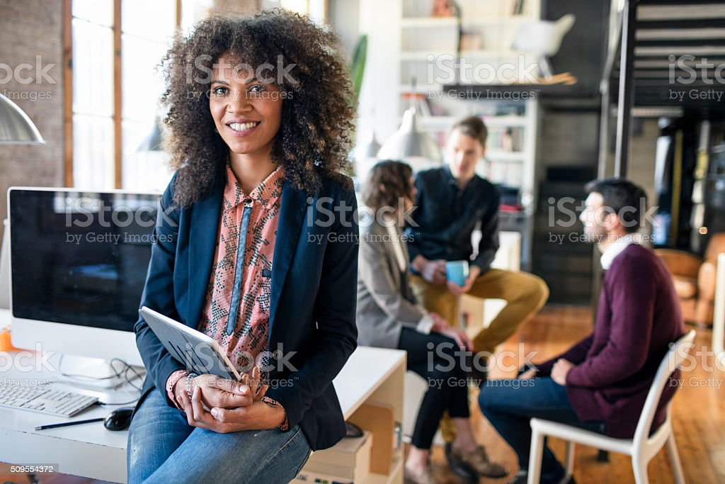 Portrait of a young entrepreneur women at the office stock photo