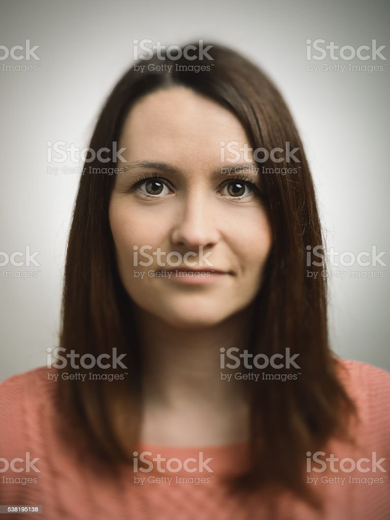 Portrait of a young european woman looking at camera stock photo