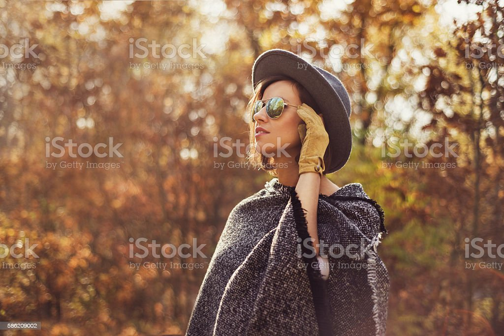 Portrait of a young, fashionable woman  outdoors stock photo