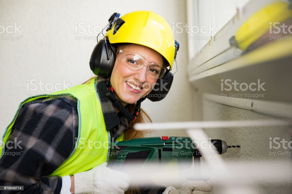 Portrait of a Young Female construction worker in hard hat stock photo