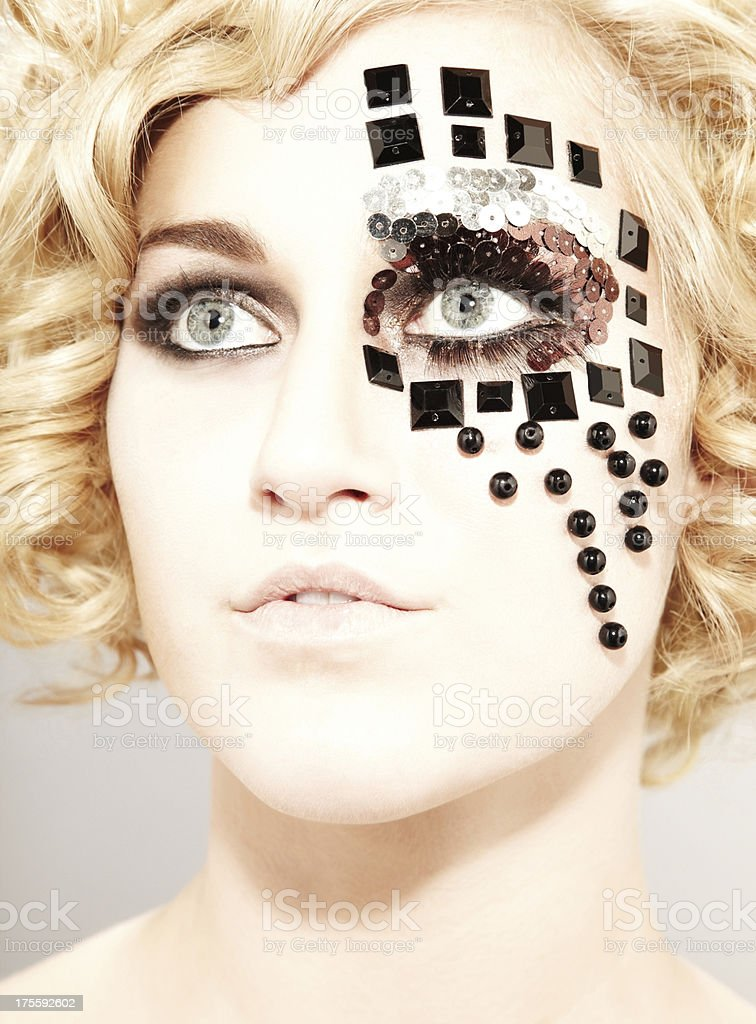 Portrait of a young female model with facial accessories royalty-free stock photo