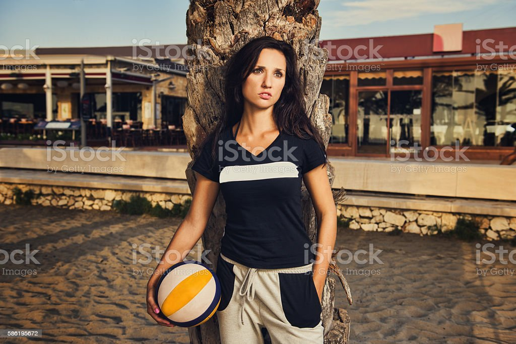 Portrait of a young, fit, beautiful girl holding volleyball ball stock photo